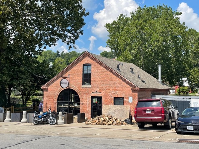 Formerly home to a blacksmith's shop, this building is now a wood-fired pizzeria. - DOUGLAS TRATTNER