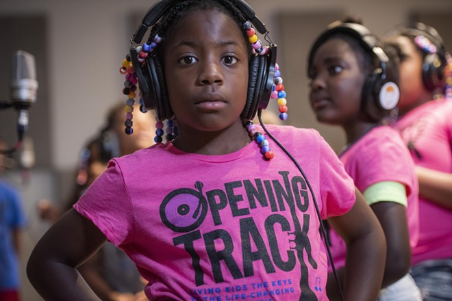 Local kids learn about music in a new BGCNEO program. - COURTESY OF BGCNEO