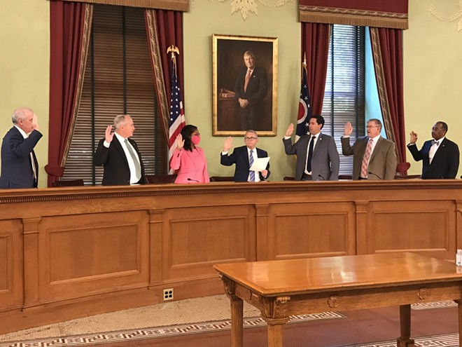 Members of the Ohio Redistricting Commission are sworn in at the Ohio Statehouse. From left, Senate President Matt Huffman, state Auditor Keith Faber, House Minority Leader Emilia Sykes, Gov. Mike DeWine, Secretary of State Frank LaRose, House Speaker Bob Cupp and Sen. Vernon Sykes. - PHOTO BY SUSAN TEBBEN