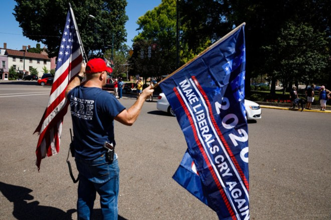 A protester with his gun and flags - GRAHAM STOKES/FLICKRCC