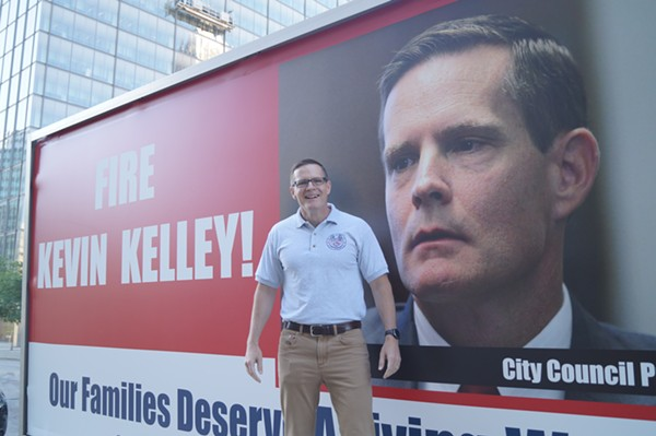 Council President Kevin Kelley volunteers for a photo in front of the SEIU Local Mobile Billboard. - SAM ALLARD / SCENE