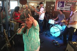 Becky Boyd takes the mic during the Blues Cruise on July 11. - ERIC SANDY