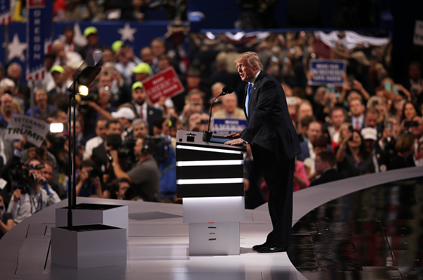 DONALD TRUMP SPEAKING ON MONDAY NIGHT. PHOTO BY EMANUEL WALLACE