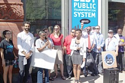 Protesters gather outside of RTA headquarters.