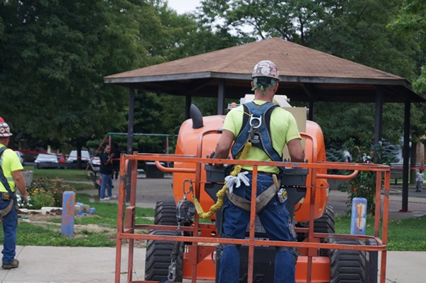 Crew from Independence Excavating approaches the gazebo. - SAM ALLARD / SCENE