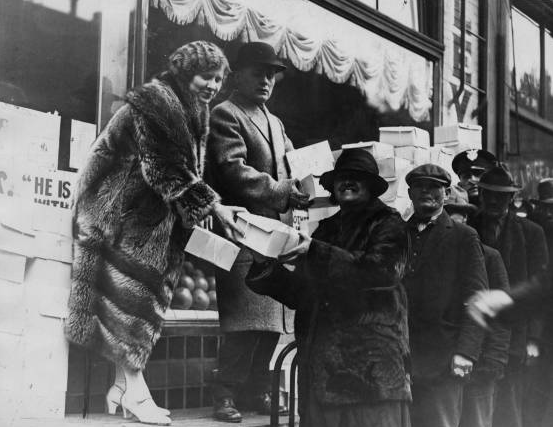 George and Alma handing out Thanksgiving boxes outside of City Hall, 1928