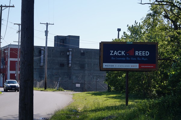 Reed has both sides of this billboard on Grand Ave., between E. 55th and Kinsman. (6/1/2017) - SAM ALLARD / SCENE