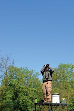 Tom Bartlett scans the skies for birds May 13 during the Biggest Week in American Birding. - PHOTO BY ERIC SANDY