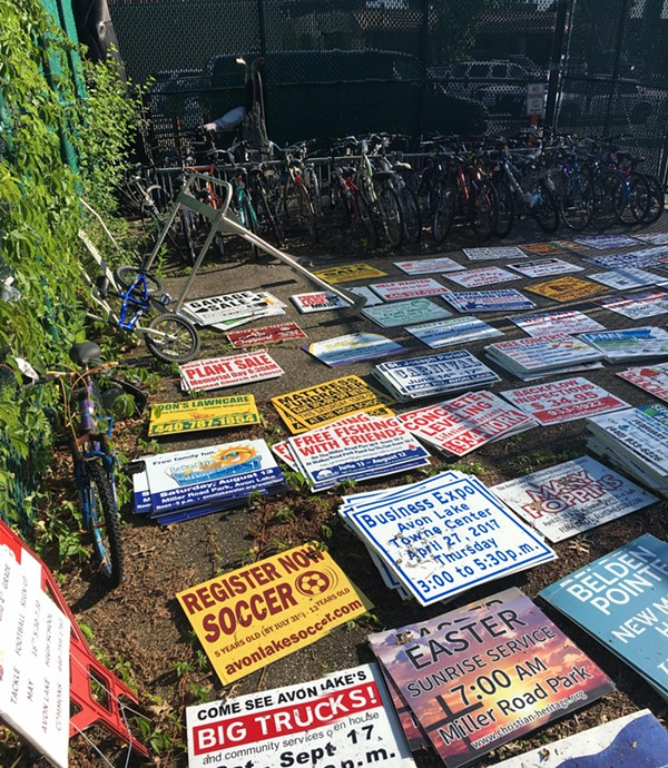Stolen yard signs from Avon Lake yards found stacked and neatly arranged. - PHOTO COURTESY OF AVON LAKE POLICE