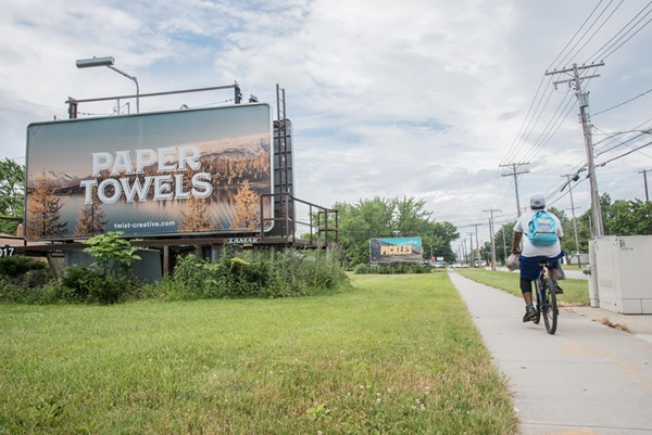 Two of Twist Creative's billboards seen around Cleveland, designed to provoke conversation. - PHOTO VIA TWIST CREATIVE/FACEBOOK