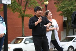 Jose Mendez speaking at the vigil. - EMANUEL WALLACE
