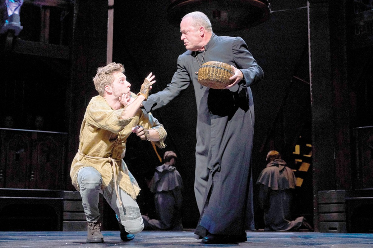 Quasimodo (Corey Mach) is reprimanded by Dom Claude Frollo (Tom Ford) in the Great Lakes Theater production of The Hunchback of Notre Dame.