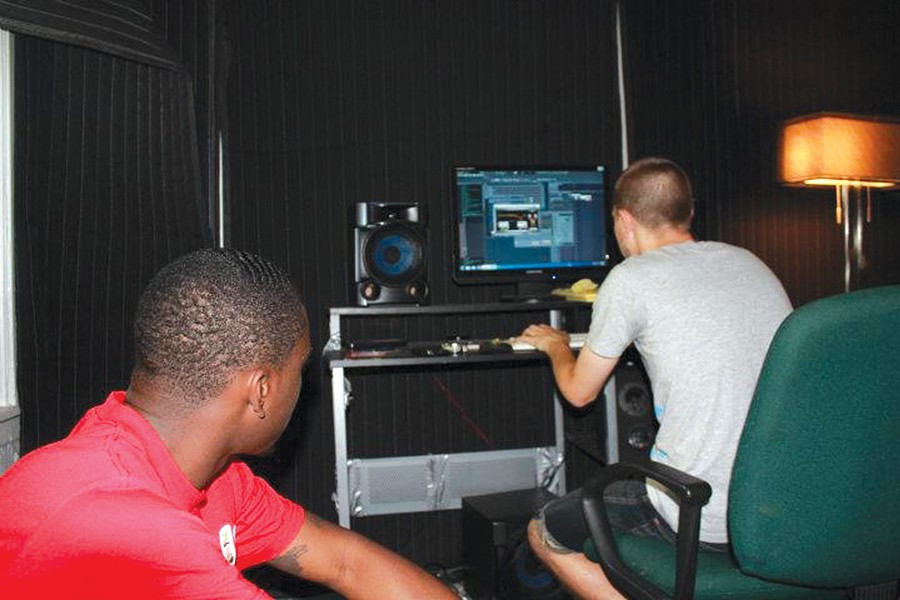 Tezo and Nate Fox in a home studio in 2007.
