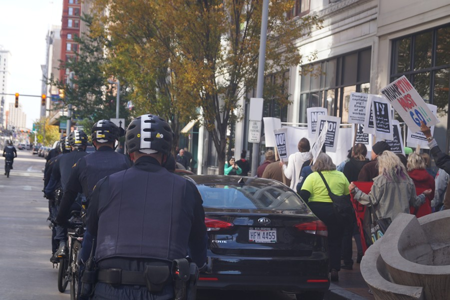Cleveland police officers on bikes followed protesters as they marched; Refuse Fascism Protest & March (11/4/2017). - SAM ALLARD / SCENE