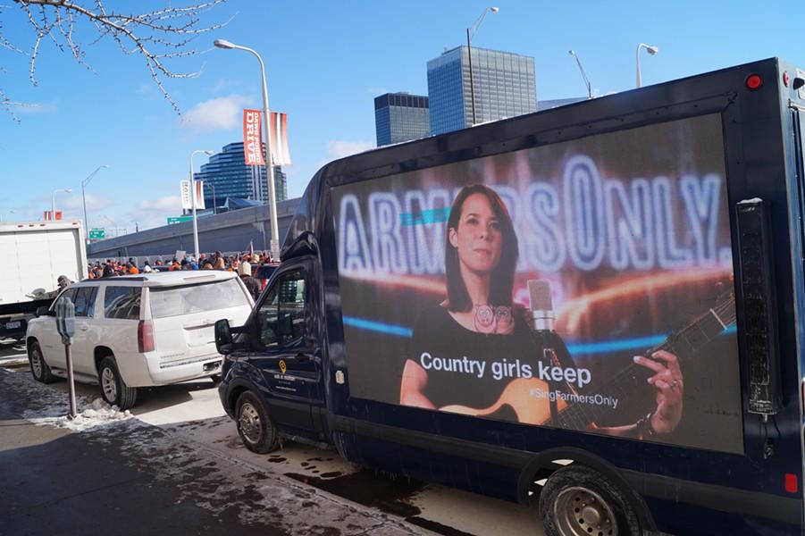 The roving billboard at the perfect season Browns parade. - PHOTO BY SAM ALLARD