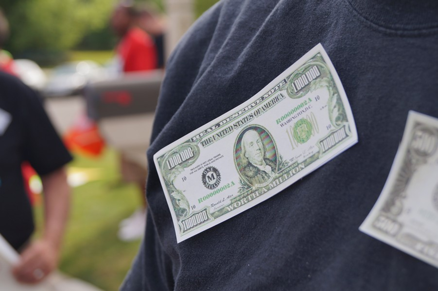 Protesters taped fake money to their clothes; Frank's Fat Cat Festival Protest (6/28/17) - SAM ALLARD / SCENE
