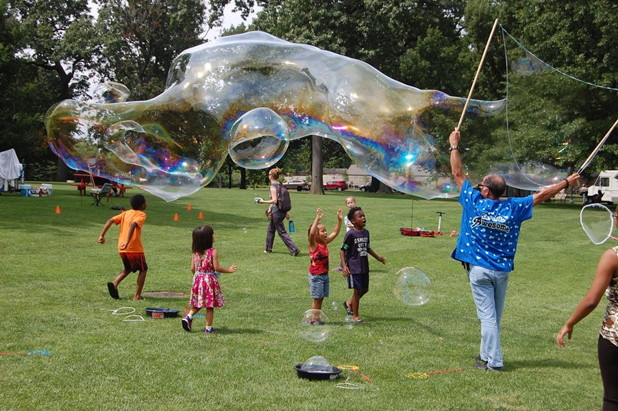 Children enjoy the bubble demonstrations on Founders' Day. - UNIVERSITY CIRCLE INC.