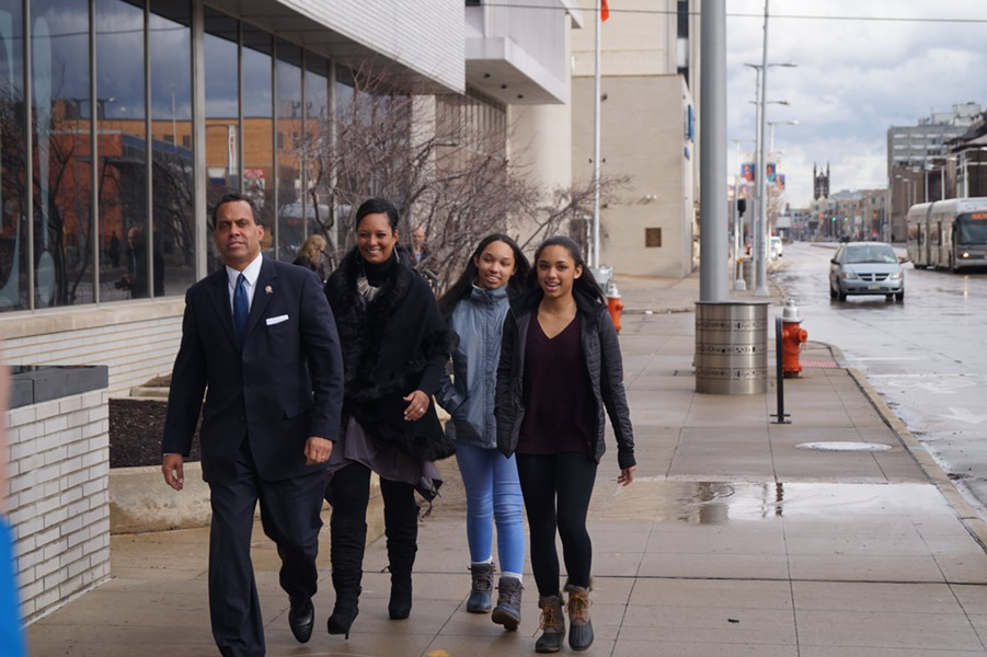Johnson arrives at the BOE with his wife Felicia and two stepdaughters, Lauren and Victoria. - SAM ALLARD / SCENE