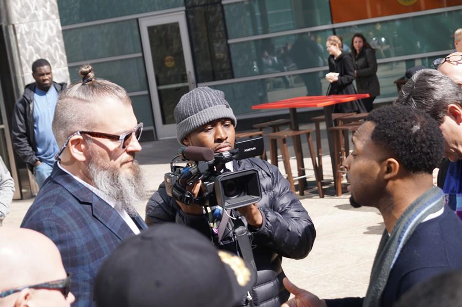 Rock Ventures' Josh McManus (L) meets the Rev. Jawanza Colvin (R) and members of GCC's Strategy Team in Detroit. - SAM ALLARD / SCENE