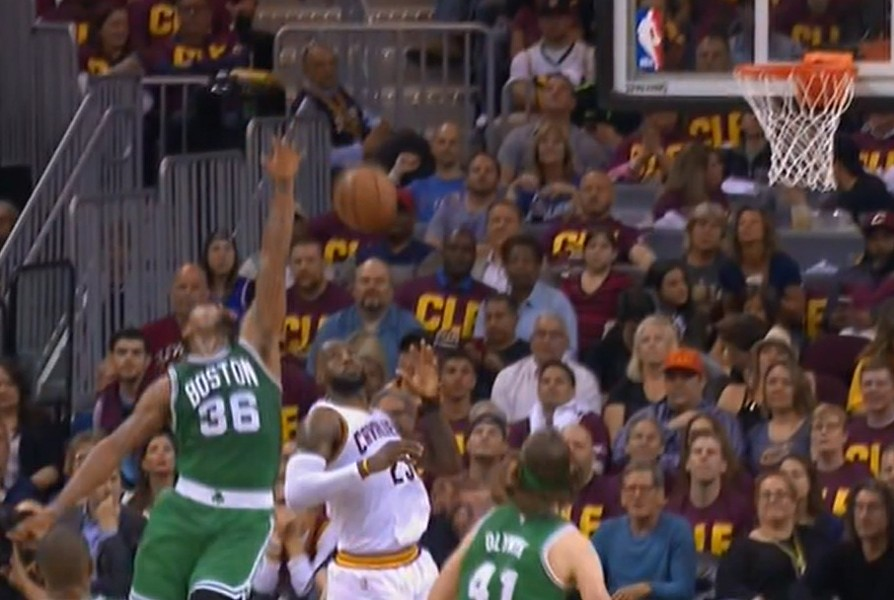 LeBron catches the bomb over Smart on way to score.