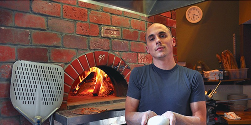 Marc-Aurele Buholzer in the kitchen of Vero, his wood-burning pizza shop in Cleveland Heights.