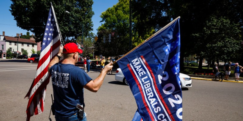 A protester with his gun and flags