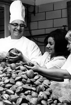 Chef John Comella of the Euclid Fish Company has assistance sorting clams for a catered clambake in 1964