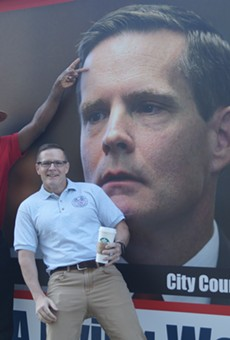 Councilmen Kevin Conwell, Kevin Kelley and Tony Brancatelli mugging in front of an anti-Kelley truck outside City Hall in 2016.