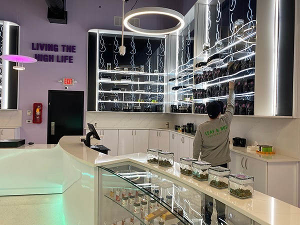 A growing industry: Leaf and Bud's neon-accented sales floor in Detroit. - COURTESY PHOTO