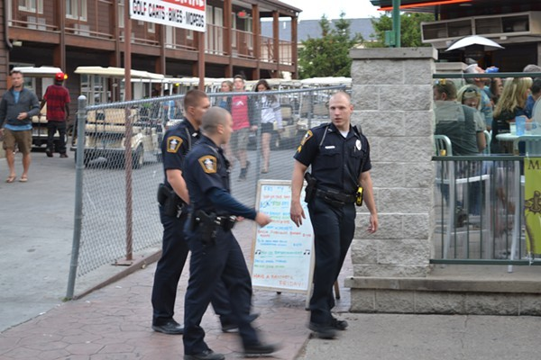 Seasonal police officers walking PIB's main drag. - DOUG BROWN / SCENE