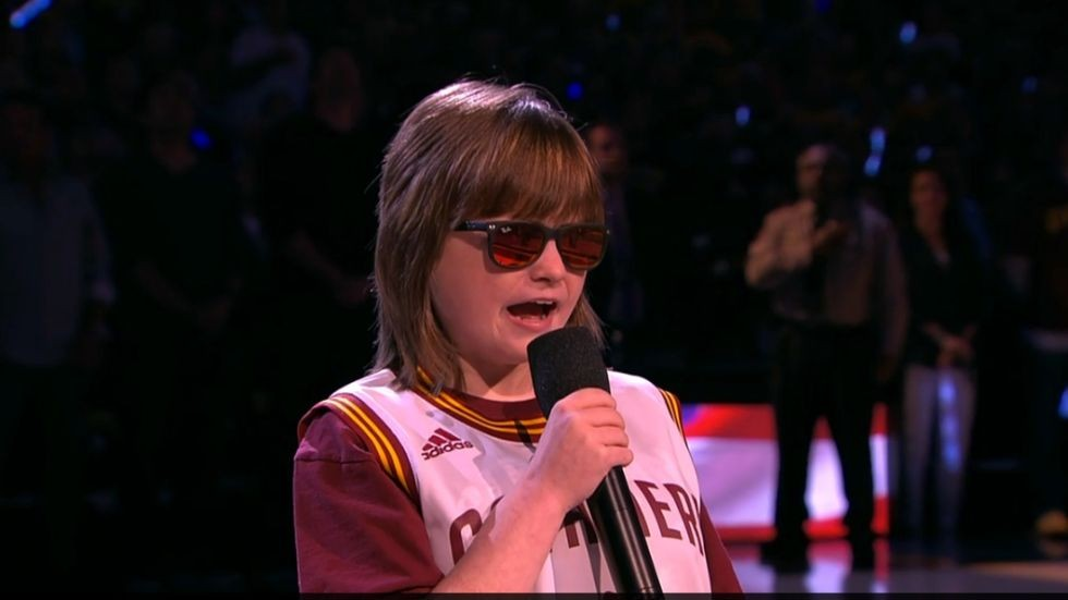 BLIND TEEN MARLANA VANHOOSE PERFORMS AT THE NBA FINALS.