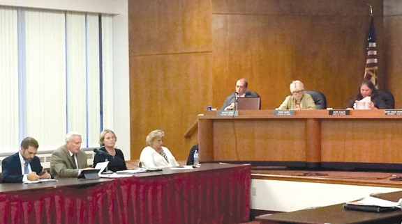 MAYOR MIKE SUMMERS, SECOND FROM LEFT, SPEAKS AT A RECENT CITY COUNCIL MEETING.