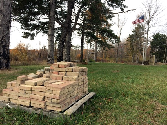 Bricks are stacked at one end of the Medina County Home Cemetery.