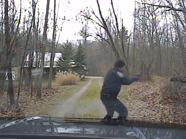 Police officer Ryan Doran draws his gun after exiting his patrol car. Al Merini is never seen in the video.