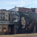 Here's a Look at the Repainted 'It's Up to Us' Mural on Clark and West 25th