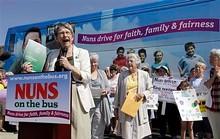 59729160_notb_-_sister_speaks_in_front_of_bus.jpg