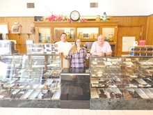 PHOTO BY DOUGLAS TRATTNER - Old owner and new owners and lots of chocolate.