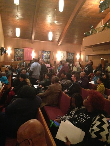 Residents stand in line to ask questions of U.S. Attorney Steven Dettelbach Monday night. - SAM ALLARD / SCENE