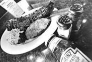 You can slide the sides onto a plate of superlative - baby-back ribs at Austin's. - WALTER  NOVAK