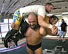 Z-list-celebrity practice session: Jason Bane hoists Gregory Iron and Johnny Gargano