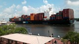 A container ship going by River Street, a familiar sight. A deepening is intended to allow ships up to three times this capacity to go up the river.