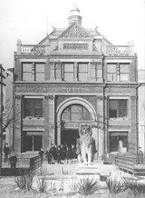 An archival print of the lion in front of the Cotton Exchange, circa 1900