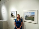 "Ashley Jones stands before a photograph of the Interstate 16 flyover at her show ""Frogtown to Victory"" at Ashmore Gallery."