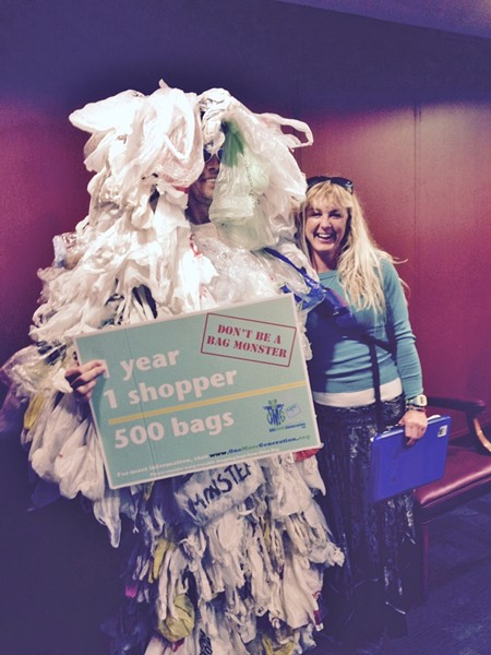 Ashley Workman of Tybee Island Resource Committee poses at the state capitol with the Plastic Bag Monster, aka Jim Ries of One More Generation.