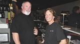 Best Bartender Paula Letcher with partner Johnny Baker at bar.food