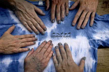 Blue fingertips are the telltale sign that these hands have been part of the indigo dyeing process. - ANN SOSBE