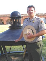 ROBIN WRIGHT GUNN - Charles E. Fenwick, superintendent of Fort Pulaski, next to the original cupola of the Cockspur Island Lighthouse