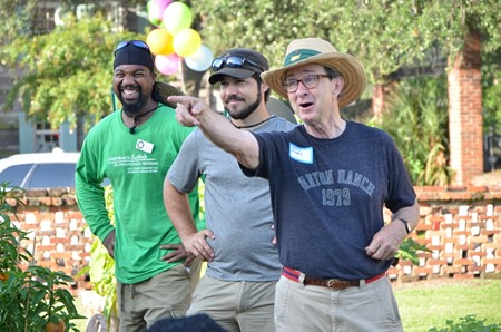 Charles H. Morris, Savannah civic leader and owner of Trustees' Garden, greets volunteers before the celebration at the CRI Healthy Garden. Also shown are Trustees' Garden Ambassador Paul Arkwright, III (left) and Kerry Shay, co-owner of Victory Gardens and advisor to the CRI Healthy Garden. Photo by James Byous, © Canyon Ranch Institute.