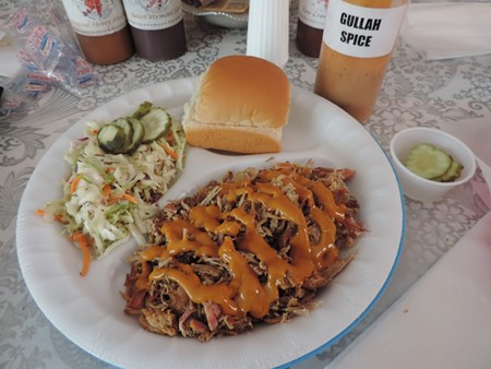 Chopped pork with plenty o' house-made Gullah Spice BBQ sauce and fresh coleslaw...