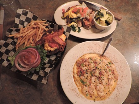 Clockwise from top right: 'Junkyard Chicken' with fresh veggies, creamy Shrimp & Grits, Sweet Tea Burger